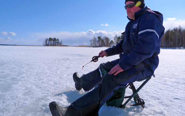 Traditional Ice Fishing Trip from Oravi